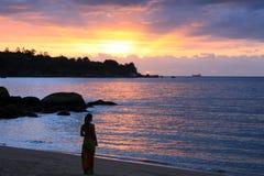 Vrouw en zonsondergang Stock Foto