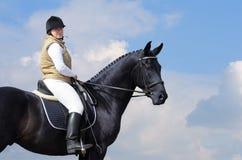 Vrouw en zwart paard Royalty-vrije Stock Afbeelding