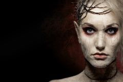 Vrouw in enge Halloween-make-up royalty-vrije stock foto's