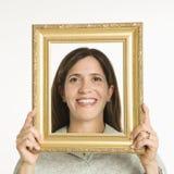 Vrouw in frame. Stock Foto's