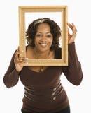 Vrouw in frame. royalty-vrije stock afbeeldingen