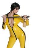 Vrouw in geel latex   Stock Foto
