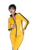 Vrouw in geel latex Stock Fotografie