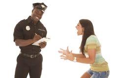 Vrouw gek bij politieagent Stock Foto's