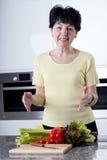 Vrouw gezond koken Stock Foto's