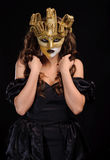 Vrouw in gouden masker Royalty-vrije Stock Foto