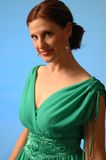 Vrouw in groene kleding Stock Afbeelding