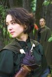 Vrouw in groene kleding Stock Foto's