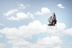 Vrouw in hemel Stock Afbeeldingen