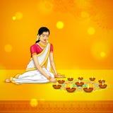 Vrouw het branden diya voor Indisch festival Diwali Stock Afbeelding