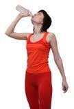 Vrouw in het drinkwater van de sportenuitrusting stock afbeeldingen