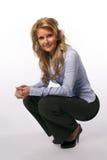 Vrouw het hurken Stock Foto