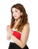 Vrouw in het rode bidden stock afbeelding