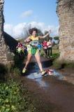 Vrouw het springen vulklei, Marathon van Epiphany, Rome, Italië Royalty-vrije Stock Afbeeldingen