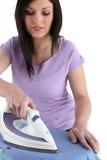 Vrouw het strijken Stock Foto