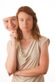 Vrouw het verbergen onder het gelukkige masker. Stock Foto