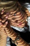 Vrouw in het zonlicht Royalty-vrije Stock Afbeeldingen