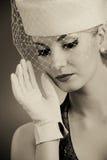 Vrouw in hoed met netto sluier royalty-vrije stock afbeeldingen