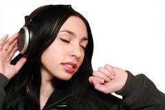 Vrouw in hoofdtelefoons Royalty-vrije Stock Fotografie