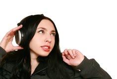 Vrouw in hoofdtelefoons Stock Fotografie