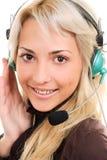 Vrouw in hoofdtelefoons Stock Foto