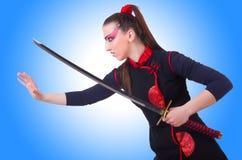 Vrouw in Japanse krijgs Stock Afbeeldingen