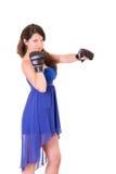 Vrouw in kleding en bokshandschoen op wit Royalty-vrije Stock Foto's