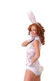Vrouw in konijnkostuum stock afbeelding
