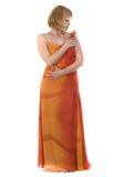 Vrouw in lang rode kleding Stock Afbeelding