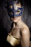 Vrouw in masker Stock Foto's