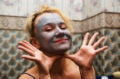 Vrouw in masker Stock Fotografie