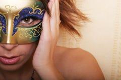 Vrouw in masker Stock Foto