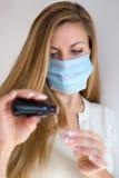 Vrouw in masker Stock Afbeelding