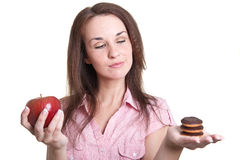Vrouw met appel en koekjes Stock Afbeelding