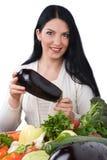 Vrouw met aubergine Royalty-vrije Stock Afbeeldingen