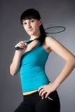 Vrouw met badmintonracket Stock Foto's