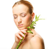 Vrouw met bamboe Stock Afbeelding
