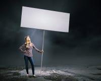 Vrouw met banner Stock Foto's