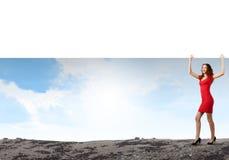 Vrouw met banner Stock Fotografie