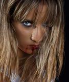 Vrouw met bloedige lippen stock foto's