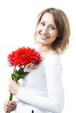 Vrouw met bloemenglimlach Royalty-vrije Stock Foto's