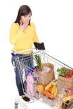 Vrouw met boodschappenwagentje Stock Foto's