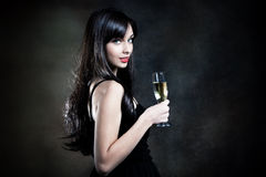Vrouw met champagne stock foto