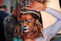 Vrouw met de Make-up van de Leeuw Stock Fotografie