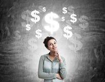 Vrouw met de schets van het dollarteken Stock Foto