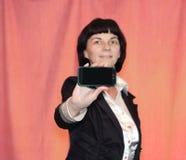 Vrouw met de telefoon Stock Fotografie