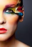 Vrouw met de valse make-up van veerwimpers Royalty-vrije Stock Fotografie