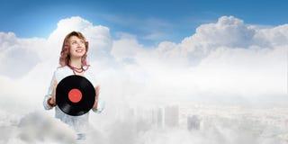 Vrouw met discoplaat Stock Afbeelding