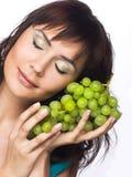 Vrouw met druiven Stock Foto's