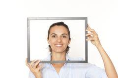 Vrouw met een frame royalty-vrije stock afbeeldingen